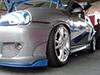 Corsa com muito tuning rodas 1000 miglia, aletas em azul, saia lateral, retrovisor estilo M3 e aber